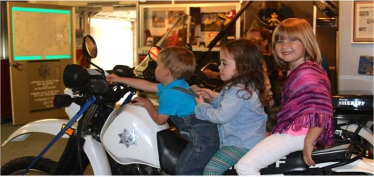 SD Sheriff Museum Kids on Motorcycle