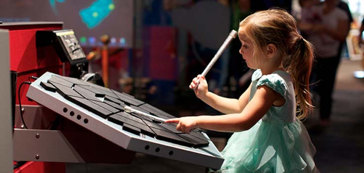 girl-playing-drums