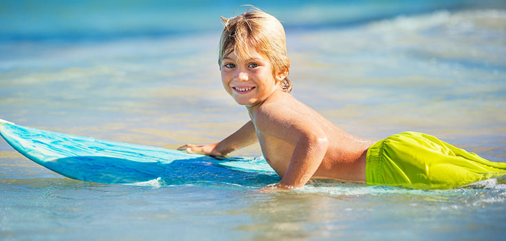 blonde-kid-surfing