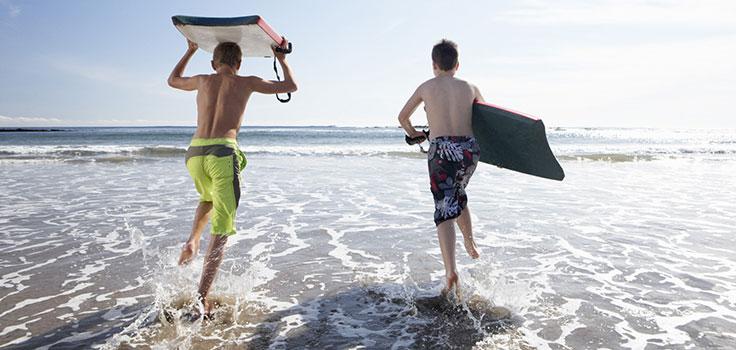 boys-boogie-boarding-ocean